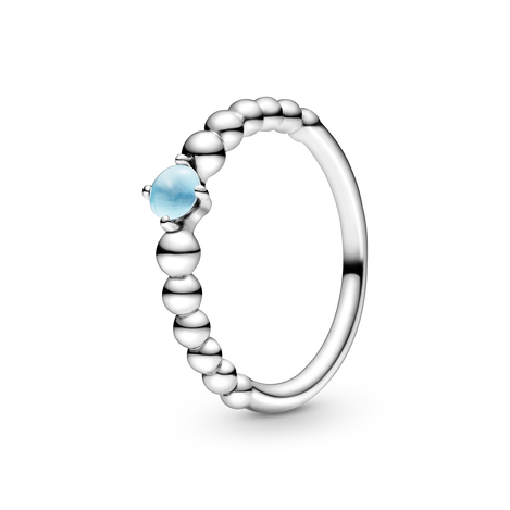 Sterling silver ring with treated sky blue topaz